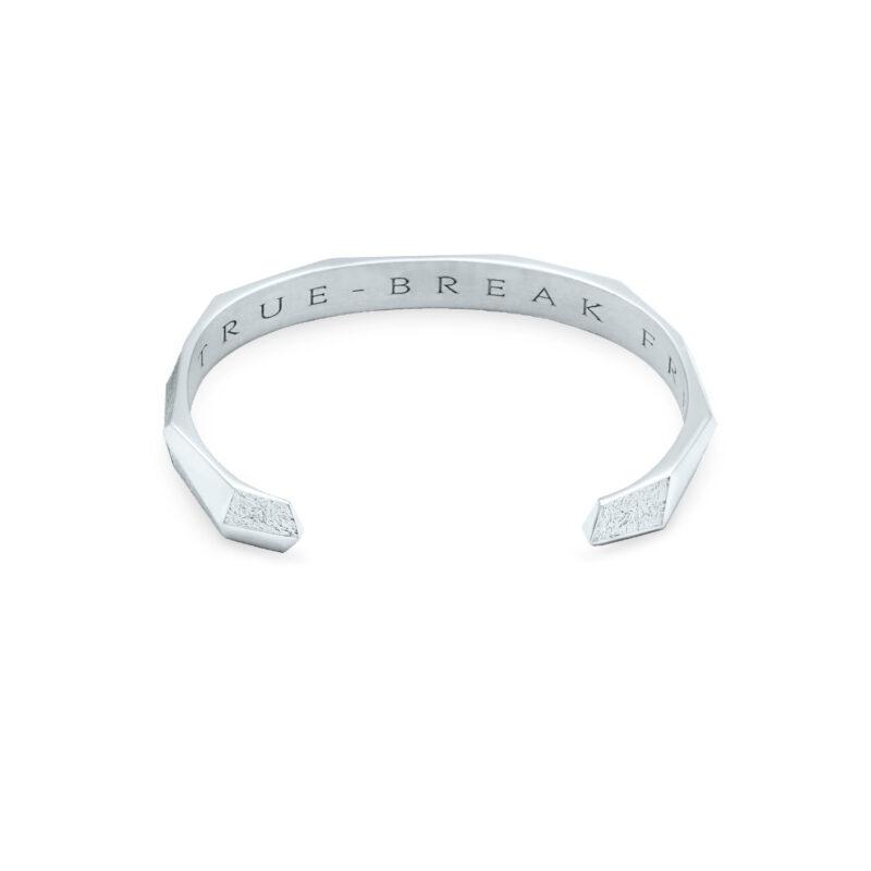 Underside Flat View of Antarktis 18k white gold bangle bracelet. Engraved is Be True. Break Free.